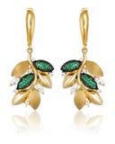Orecchini dell'oro con le gemme verdi Fotografie Stock