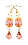 Orecchini in vetro rosso con gli elementi dell'oro. fondo bianco Fotografie Stock