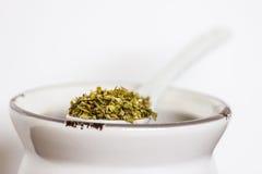 Oregano on ceramic spoon Stock Photo