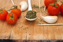 Oregano, garlic and red cherry tomato Stock Images