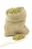 Oregano leaves in burlap bag Stock Photos
