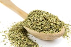 Oregano spice on wooden spoon Stock Photo