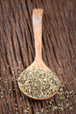 Oregano in spoon on the wood table stock images