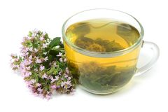 Oregano tea with flowers Royalty Free Stock Photos