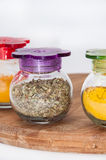 Oregano, turmeric and curry in a glass bowl Royalty Free Stock Photos