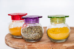 Oregano, turmeric and curry in a glass bowl Royalty Free Stock Images