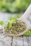 Oregano on a wooden spoon Stock Image