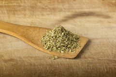 Oregano in a wooden spoon Stock Photography