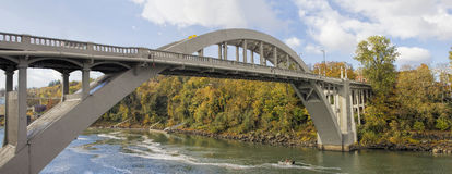 Oregon City Arch Bridge Over Willamette River in Fall. Oregon City Arch Bridge Over Willamette River Connecting West Linn and Oregon City Autumn Scene Panorama Royalty Free Stock Images
