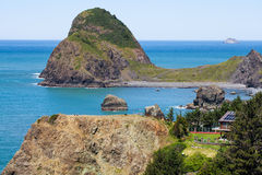 Oregon coast with buildings on a cliff. Coastal landscapes, ocean scenic view.  Royalty Free Stock Images