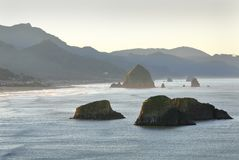 Oregon Coast, Cannon Beach, Dawn. High angle view of Cannon Beach at dawn with famous Haystack Rock in the background. Oregon, United States royalty free stock photography
