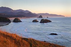 Oregon Coast, Cannon Beach, Dusk. Ecola State Park at dusk. Cannon Beach with famous Haystack Rock in the background. Oregon, United States stock images