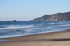 Oregon coast cliffs meet the ocean aves. Oregon Coast where the green rocky cliffs meet the ocean waves Stock Images