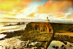 Oregon coast portrait. Portrait of the Cape Arago lighthouse along the Oregon coast at sunset during low tide Stock Images