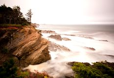 Oregon coast portrait. Long exposure, waves crashing up against the rock cliffs along the Oregon coast Stock Image