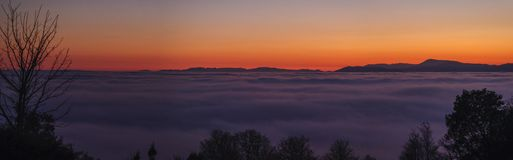 Oregon Coast Range Silhouette Sunset with Fog (2 o Royalty Free Stock Photo