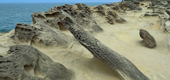 Oregon Coast - Rock Formations - Panorama. A panoramic view of the water and wind eroded sand stone rock formations along the Pacific coastline. Taken at Shore Royalty Free Stock Photos