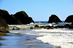 OREGON COASTLINE BEACH. Rushing waves during high tide on Cannon beach Oregon Stock Photos