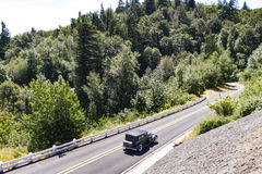 Vintage car on Columbia River road, Oregon. Vintage car driving road along the Columbia River in Oregon stock photo