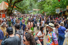 Oregon Country Fair. A crowded collection of hippies and tourists of all ages make their way along the wooded path at the Oregon Country Fair near Eugene, Oregon royalty free stock photos