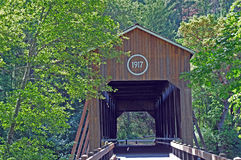 Oregon covered bridge. Old covered Oregon bridge sits amid greenery royalty free stock photo