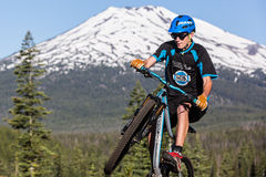 Oregon Enduro #2 - Bend. Alex Grediagin in front of Mt. Bachelor, less than 20 miles from the town of Bend, Oregon.   Mt. bachelor will host the 2015/16 USA Royalty Free Stock Photo