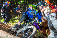 Oregon Enduro Series - Joe Lawwill. Joe Lawwill in hecklers row, where riders had to run a gauntlet of costumed revelers in a series of s-turns Royalty Free Stock Images