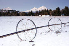 Irrigation Device Oregon Farm Wintertime Mountains Royalty Free Stock Photos