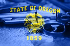Oregon flag U.S. state Gun Control USA. United States Gun Laws.  Royalty Free Stock Photo