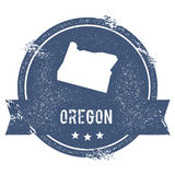 Oregon mark. Travel rubber stamp with the name and map of Oregon, vector illustration. Can be used as insignia, logotype, label, sticker or badge of USA state Stock Image