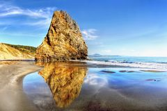 Oregon Pacific Coast, Amazing Rock Reflection Ocean. Amazing rock and sky reflection in the waters of the Pacific Ocean. Cape Blanco State Park, Oregon Pacific stock image
