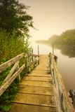 Oregon portraits. View of a dock that leads to a misty lake on a foggy morning Stock Photos