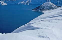 Oregon's Crater Lake in Snow. Crater Lake in Oregon is surrounded by pristine white snow Stock Images