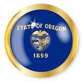 Oregon Flag Button. Oregon state flag button with a gold metal circular border over a white background Royalty Free Stock Photos