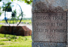 Oregon Trail Marker. Marker for the historic Oregon Trail with wagon wheel in background Royalty Free Stock Photo