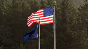 Oregon And United States Flags Flying In Strong Wind. Back Side Of Oregon Flag With United States Flying stock footage