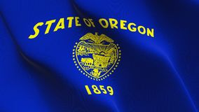 Oregon US State flag waving on wind. United States of America Oregon background fullscreen flag blowing on wind. Realistic fabric texture on windy day Royalty Free Stock Photography