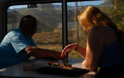 Oregon, USA - August, 4 2014: Train passengers pass the time on. Train passengers pass the time on their journey down the West coast of America, with view of Stock Photo