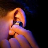 Oreille avec l'écouteur Image libre de droits