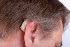 Oreille et prothèse auditive Photos stock