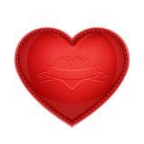 Oreiller en cuir rouge comme coeur Photos stock