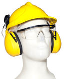 Orejera, gafas y casco en maniquí Foto de archivo