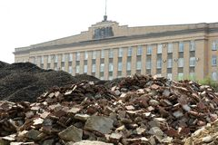 Orel city administration building and huge piles of construction. Waste in foreground horizontal stock photography