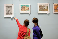 Orel, Russia - April 22, 2016: Girls looking at picture exhibiti Royalty Free Stock Photos