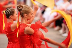 Orel, Russia - August 04, 2016: Brass bands fest. Girls in red d Stock Photos
