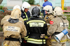 Orel, Russia, August 29, 2017: Collapse of old apartment house. EMERCOM rescue team in uniforms and helmets closeup Royalty Free Stock Photography