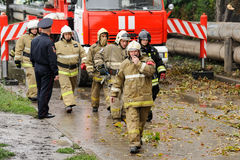 Orel, Russia, August 29, 2017: Collapse of old apartment house. EMERCOM rescue team going from red fire truck horizontal Royalty Free Stock Photo