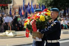 Orel, Russia - August 5, 2015: military men laying flowers on et Royalty Free Stock Images