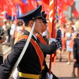 Orel, Russia - August 5, 2015: military men with red banners on Stock Photos