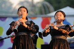Orel, Russia - August 05, 2016: Orel city day. Chinese girls pla. Ying clarinets on stage stock image